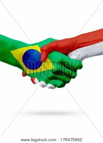 Flags Brazil Monaco countries handshake cooperation partnership friendship or sports team competition concept isolated on white