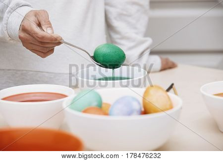 hands of the woman preparing Easter eggs