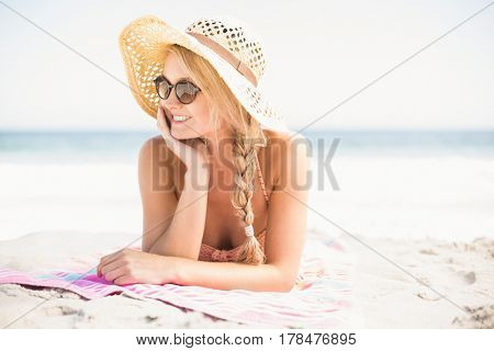 Happy women lying on the beach at sunny day