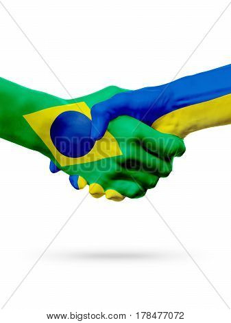 Flags Brazil Ukraine countries handshake cooperation partnership friendship or sports team competition concept isolated on white