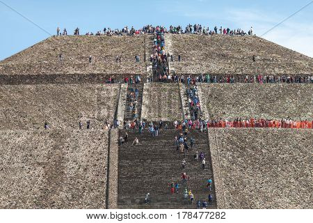 people climb the steps to the Pyramid of the Sun. Mexico