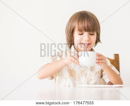 Cute kid on table at home