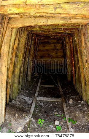 Old roman tunnel in gold mine Rosia Montana, Transylvania. Rosia Montana is a commune of Alba County in the Apuseni Mountains of western Transylvania, Romania.The rich mineral resources of the area have been exploited since Roman times or before.