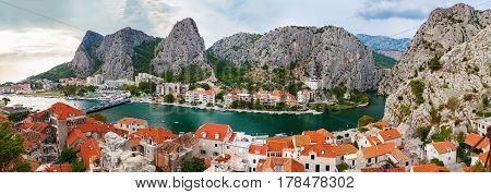 aerial panoramic landscape of the small town Omis surrounded with mountains Makarska Riviera Croatia