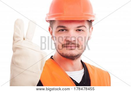 Smiling Construction Worker Showing Two Fingers