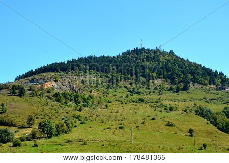 Landscape in Apuseni Mountains. The Apuseni Mountains is a mountain range in Transylvania, Romania, which belongs to the Western Romanian Carpathians, also called Occidentali in Romanian. The Apuseni Mountains have about 400 caves