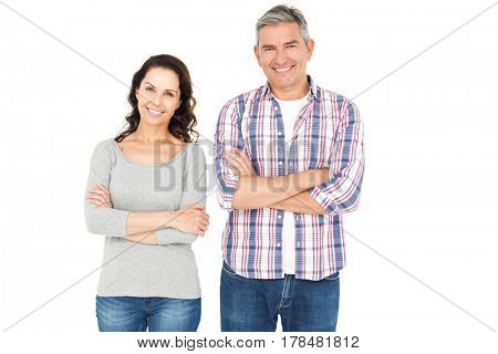 Smiling couple with crossed arms looking the camera on white background