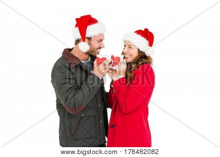 Happy young couple holding coffee mug on white background