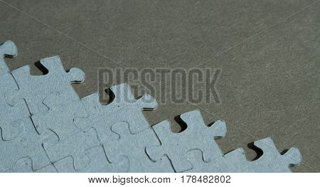 Jigsaw Puzzle pieces on black background with copy space