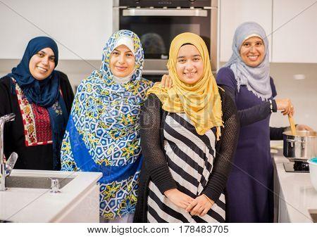 Arabian girls and women in kitchen