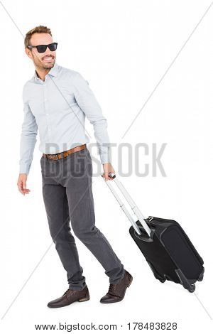 Young man with trolley bag on white background