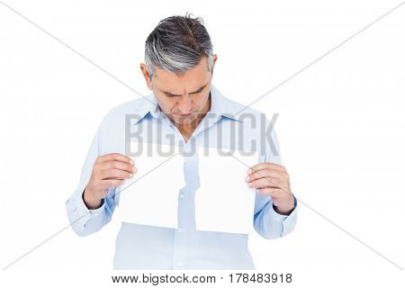 Man holding torn white paper on white background