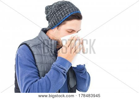 Man blowing his nose on white background