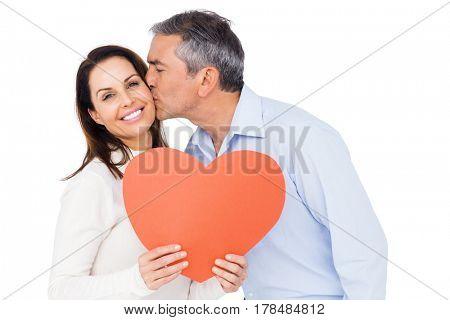 Lovely couple holding big heart on white background