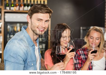 Friends smelling wine at bar