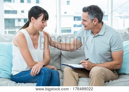 Therapist consoling a woman in the clinic