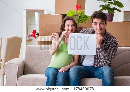 Young couple expecting baby with blank message