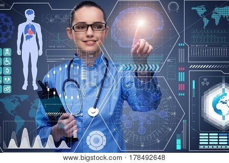 Doctor in futuristic medical concept pressing button