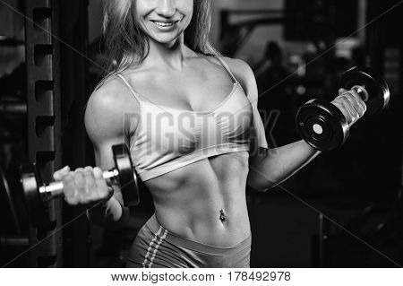 Caucasian Pretty Fitness Girl On Diet Training Pumping Up Muscles