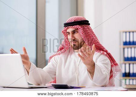 Arab businessman working on laptop computer