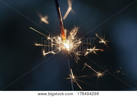 Sparkler burning and glowing in the dark