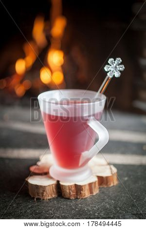 Mulled wine for one in front of fireplace