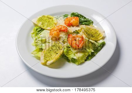 Caesar Salad With Seafood And Croutons Dressed With Parmesan Cheese