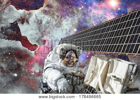 Astronaut in outer space. Spacewalk. Elements of this image furnished by NASA.