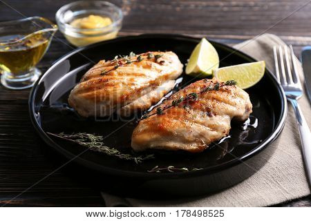 Delicious chicken breasts with lime on plate