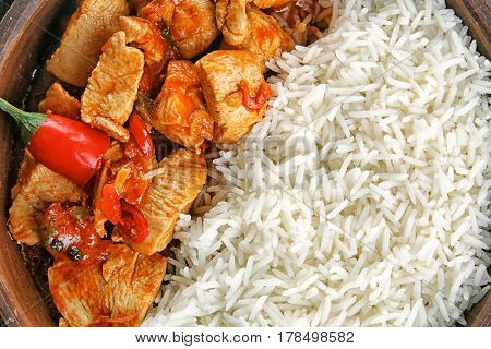 Portion of chicken tikka masala and rice, closeup