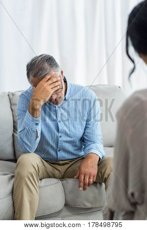 Female doctor consulting a man at home