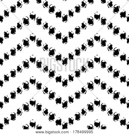 Black and white hand painted dot chevron ornament grunge seamless pattern, vector background