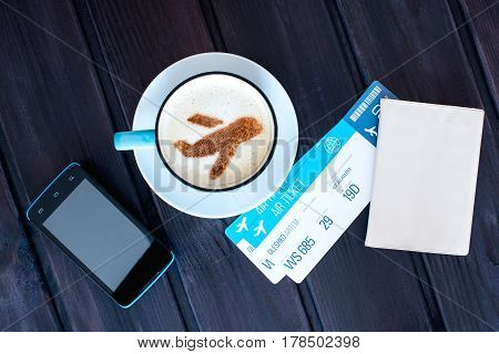 Cup Of Coffee With The Airplane Of Cinnamon On Foam