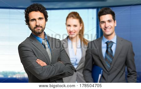 Three businesspeople welcoming you