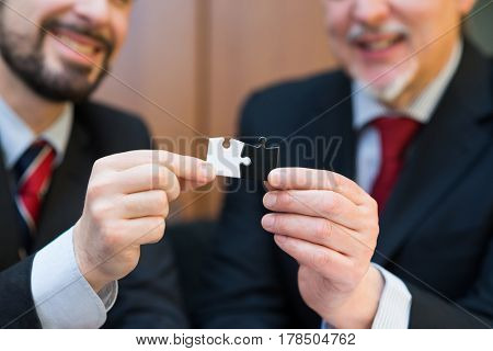 Business concept, businessmen putting puzzle pieces together