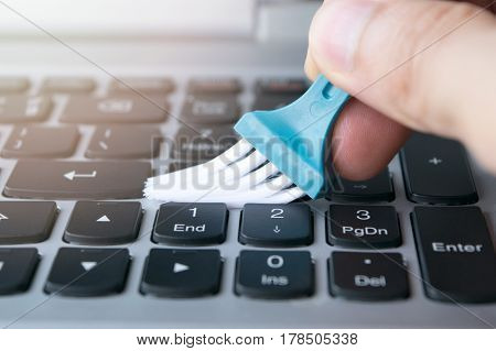 Close Up Hold Brush Cleaning On Keyboard Notebook