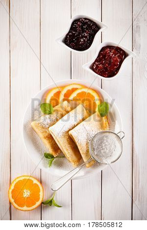 Crepes with fruits and cream
