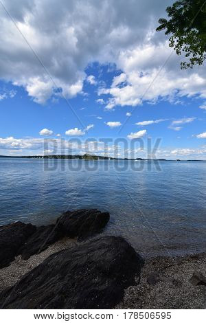 Beautiful scenic view from a rocky beach in Casco Bay in Maine.