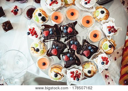 spartak cake on plate with other bakery. wedding candy bar