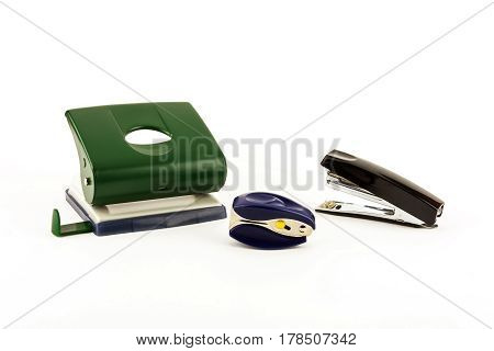 Stationery - Stapler anti-stapler and puncher on a light background