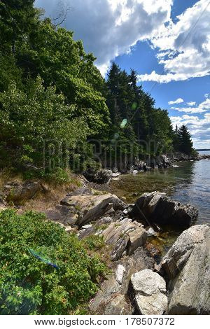Rock lined shore of an island in Casco Bay Maine.