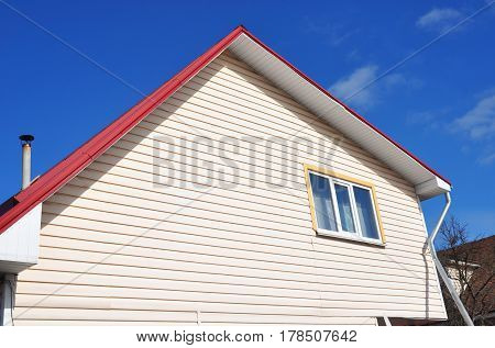 House Construction. Siding House - Vinyl Siding