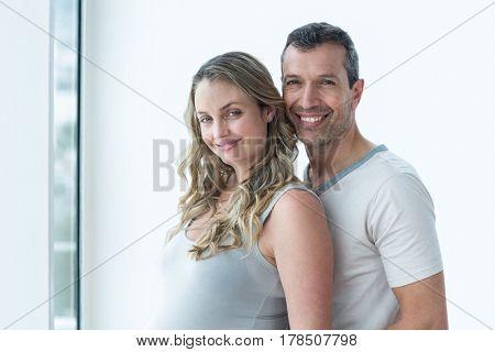 Portrait of couple smiling in bedroom