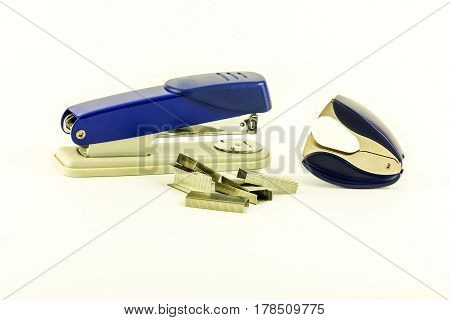 On a white background lie a stapler staples for stapler and anti-stapler