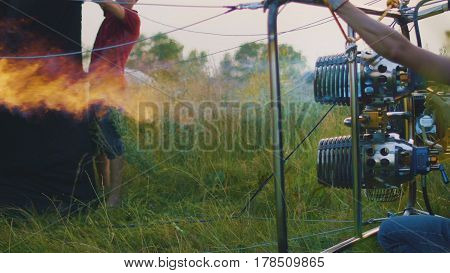 Power double burner burns hot air balloon, close up, close up
