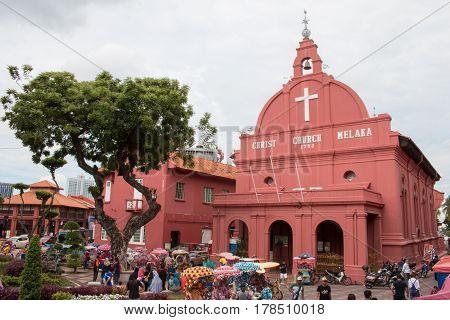 Malacca, Malaysia - Mar 22: Christ Church & Dutch Square And Tourist Group In Malacca, Malaysia. Mal