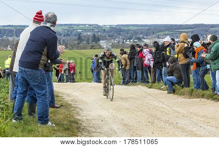 VendomeFrance- March 72016:The French cyclist Pierre-Luc Perichon of Team Fortuneo-Vital Concept riding on a dirty roadTertre de la Motte in Vendome during the first stage of Paris-Nice 2016.