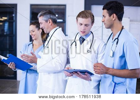 Medical team discussing the medical report together in hospital