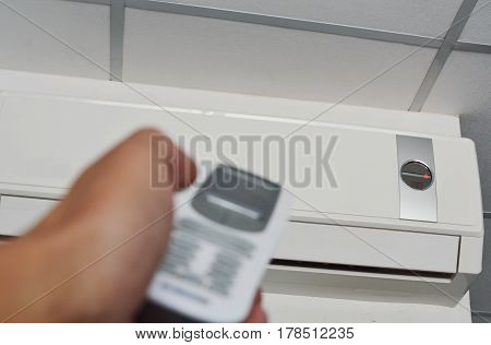 hand open air conditioner on ceiling by remote control