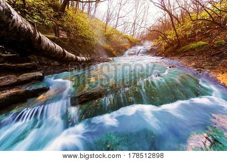 Oyunumagawa Hot spring waterfall with sunset light near Jigokudani hell valley Noboribetsu Hokkaido Japan
